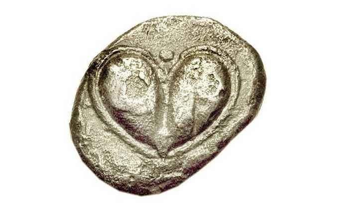 Moneta che raffigura il seme di silfio